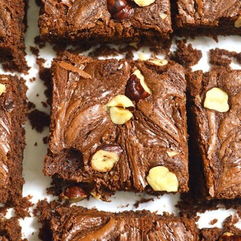 nutella brownies with nutella swirl and hazelnuts topping