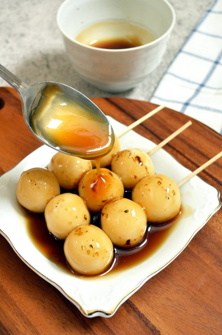 pouring sweet soy sauce to dango