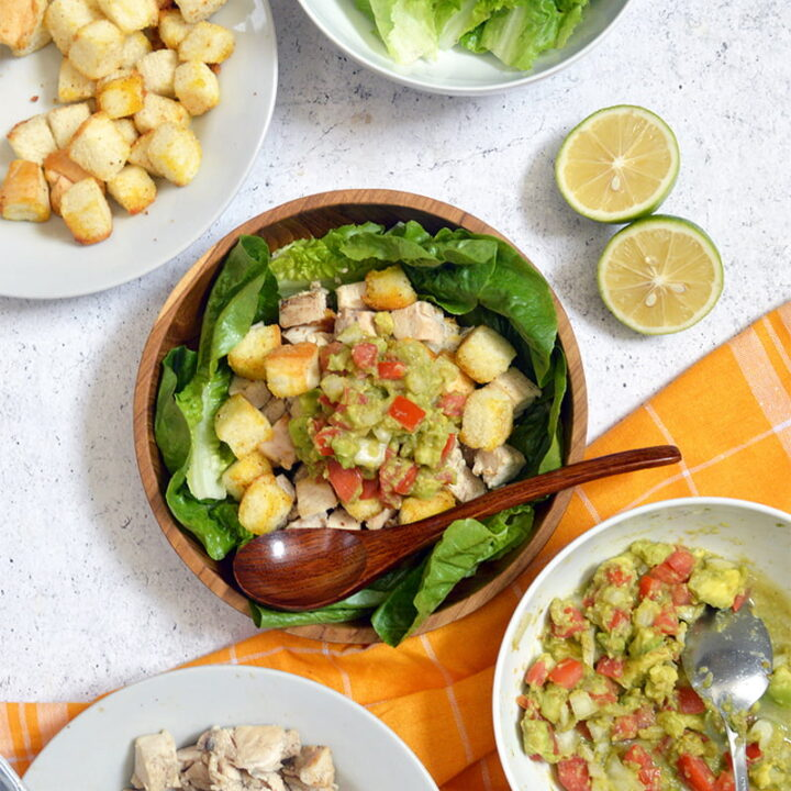pan fried chicken and salad with guacamole dressing and croutons