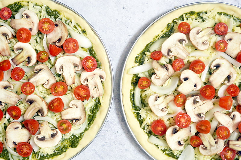 mushroom pesto pizza with mozzarella and cherry tomatoes