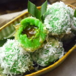 pandan glutinous rice balls with palm sugar filling and grated coconut coatin