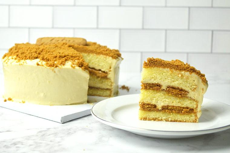 biscoff lfresh cream cake with biscoff cookies in between