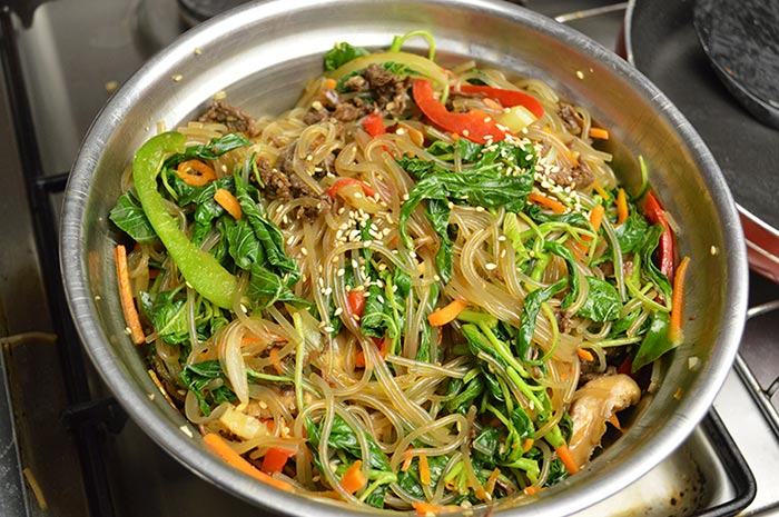 mixing all the ingredients of japchae